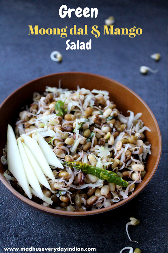 sprouted green moong dal salad topped with green mango