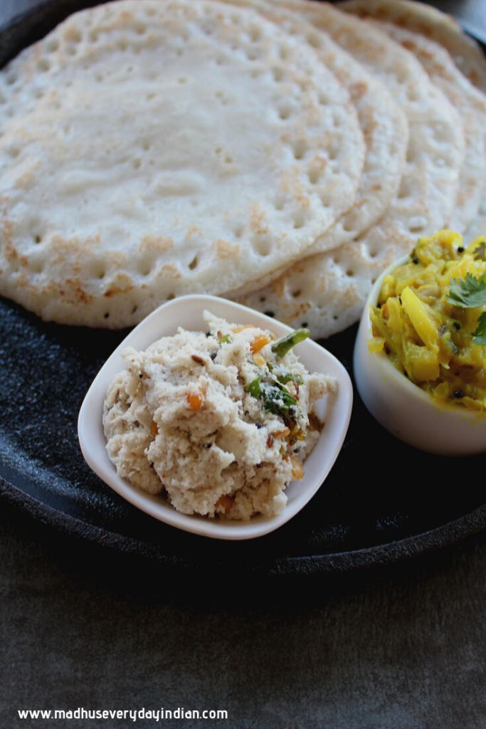 coconut chutney served with poha dosa and potato curry