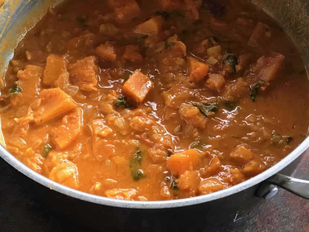 pumpkin curry ready to serve in a steel sauce pan