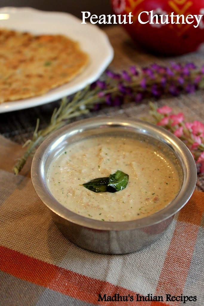 peanut chutney served in a small steel bowl