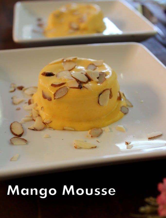 Mango Mousse Recipe- This creamy mango mousse recipe is very easy to make. Its an egg less recipe, no gelatin or agar agar is used.