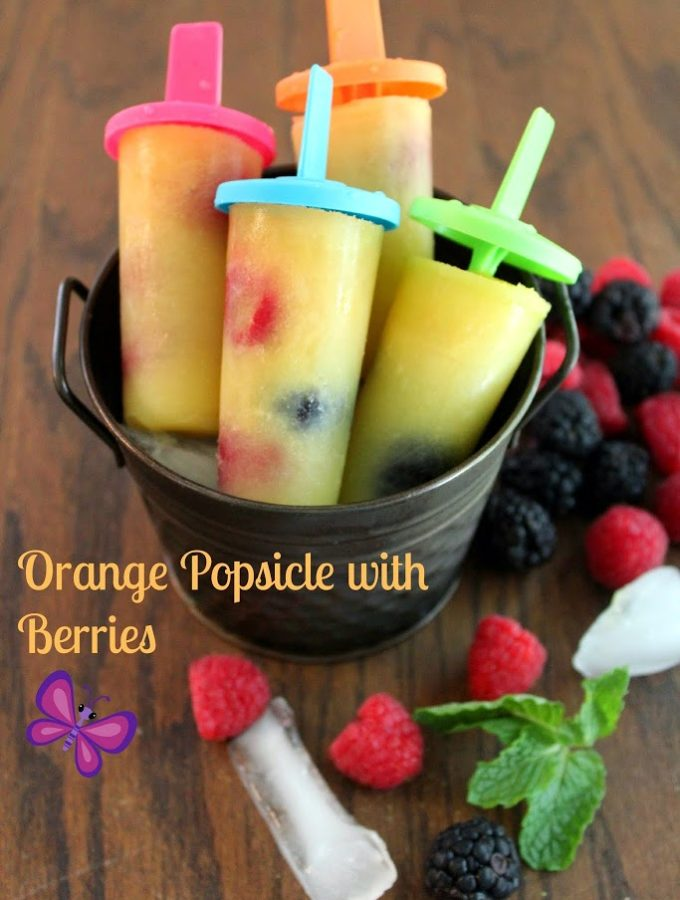 orange popsicle with berries and mint