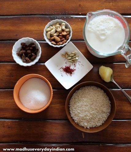 rice kheer ingredients- milk, rice, sugar, ghee, nuts, cardamom and saffron