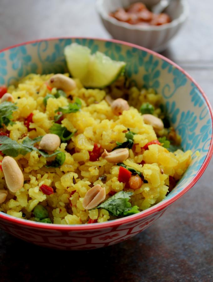 aval upma or poha upma served with mango pickle