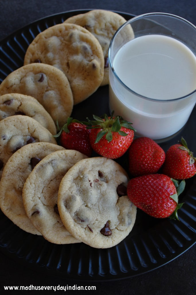 eggless chocolate chip cookies with milk and strawberries
