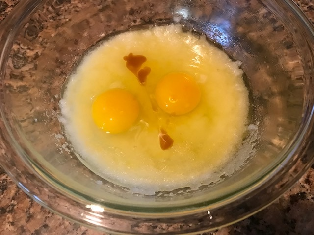 added eggs and vanilla extract in a large glass bowl