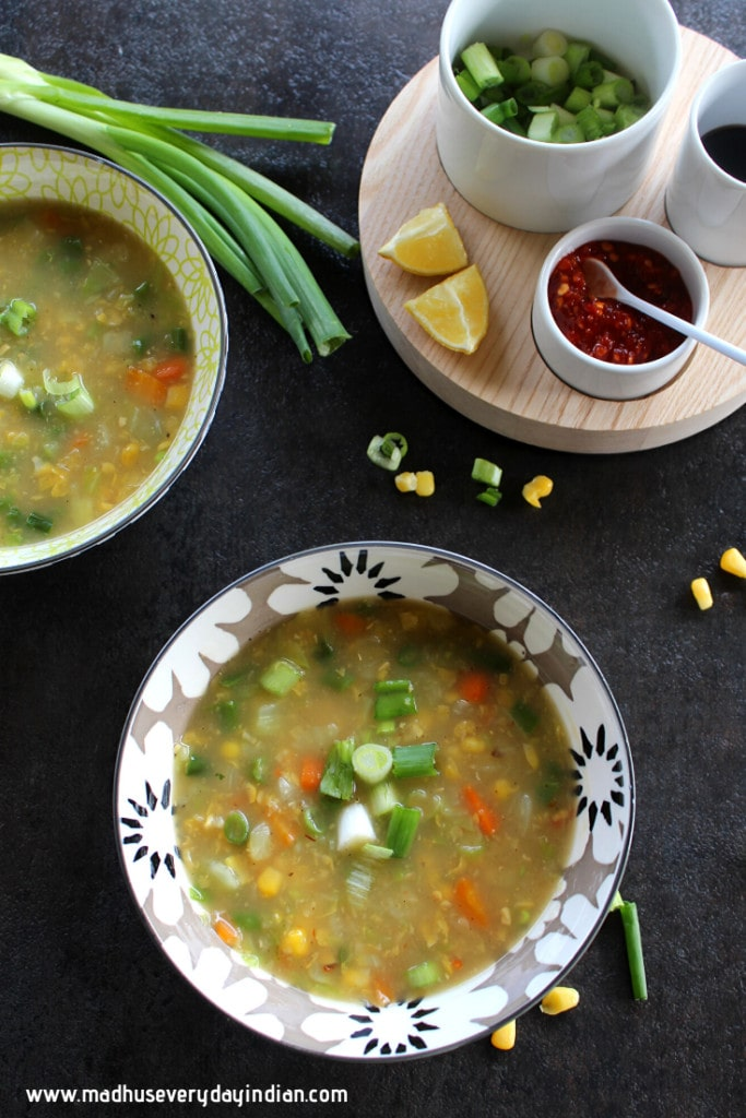 sweet corm vegetable soup served in a bowl and topped with green onion