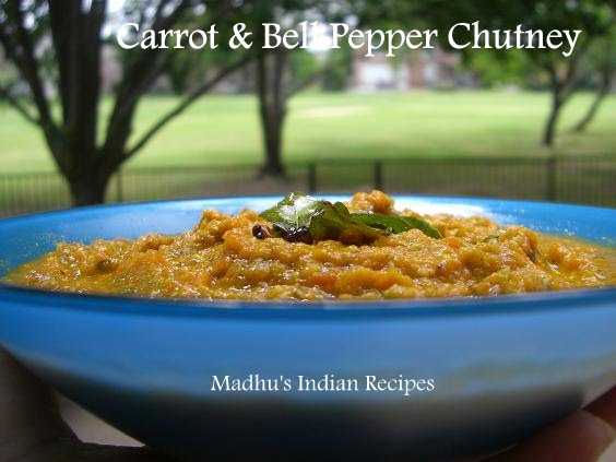 carrot bell pepper chutney served in a blue bowl