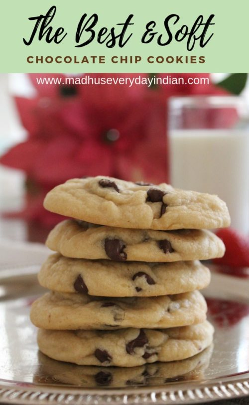 stacked chocolate chip cookies served with a cup of cold milk