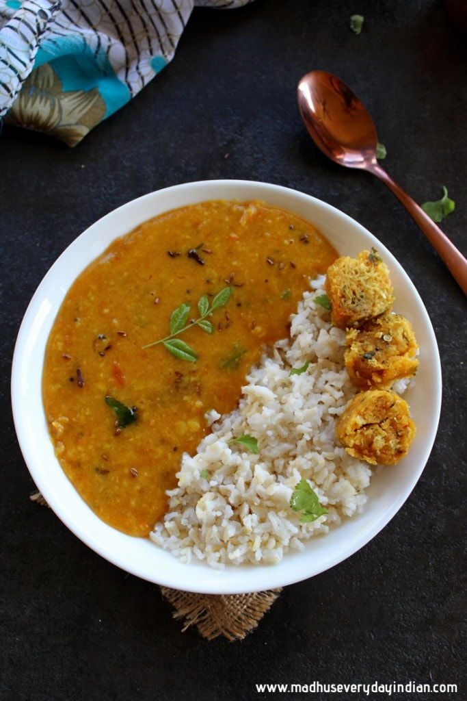 gujarati dal served with rice and muthia