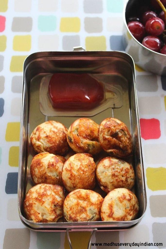 kuzhi paniyaram served with ketchup and grapes