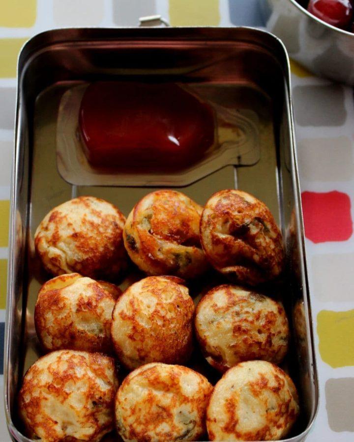 ponganalu or paniyaram served with ketchup