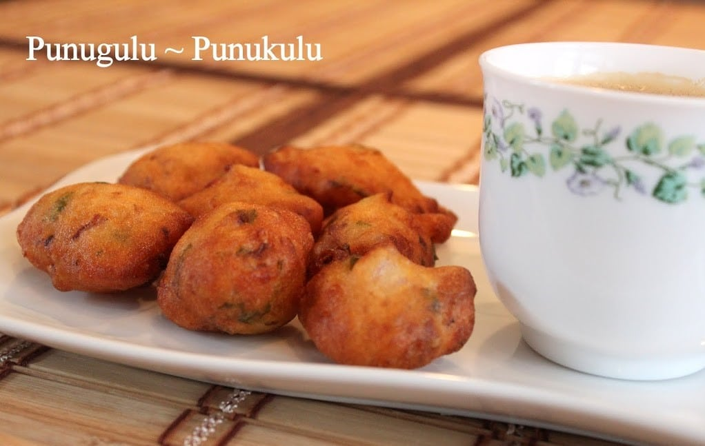 punugulu served with coffee in a white plate