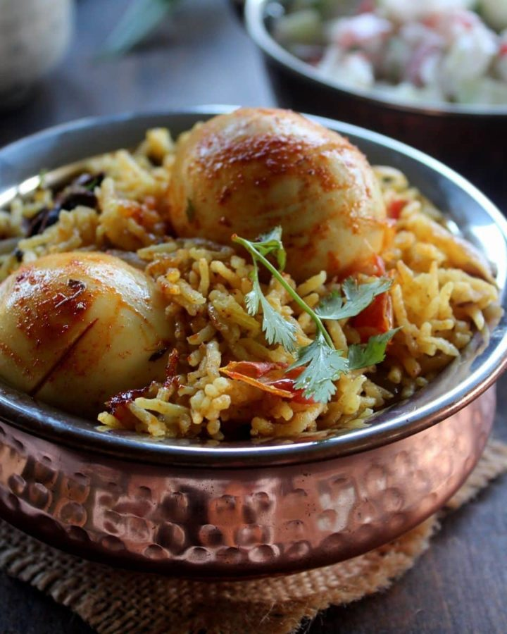 instant pot egg biryani served in a copper pot