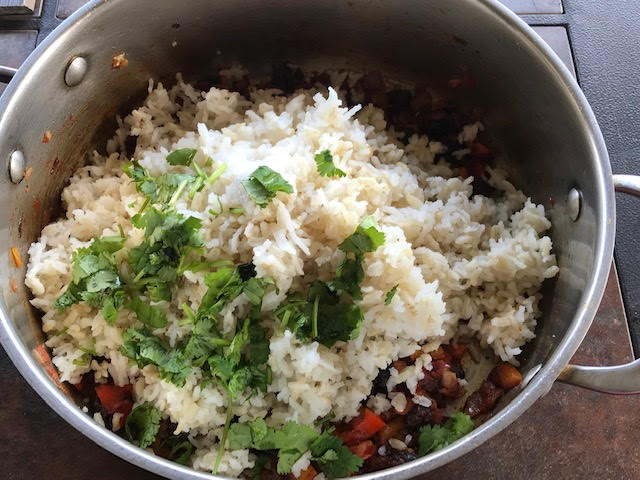 adding rice to the mexican rice recipe
