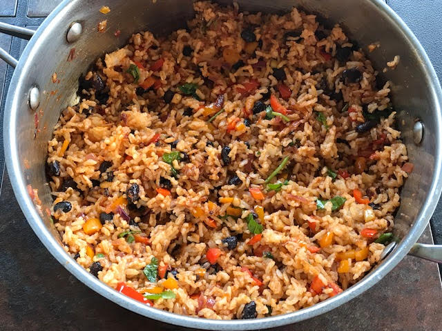 mexican rice made in a wide steel pan