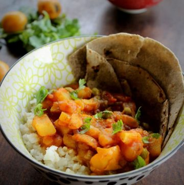 potato loquat curry served with rice and roti