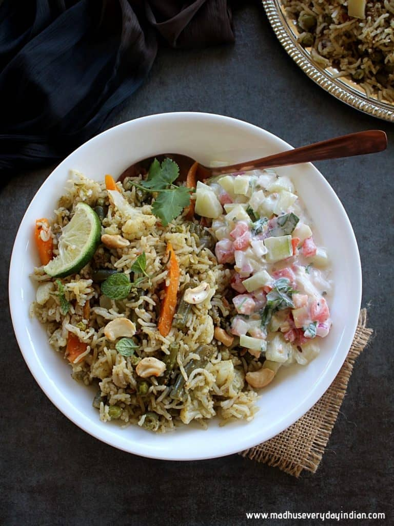 vegetable pulao served with raita in a white plate