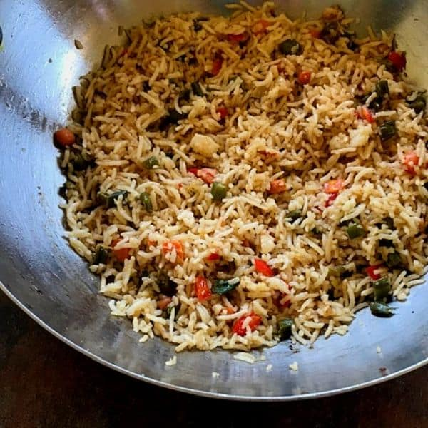 fried rice served in a large steel wok