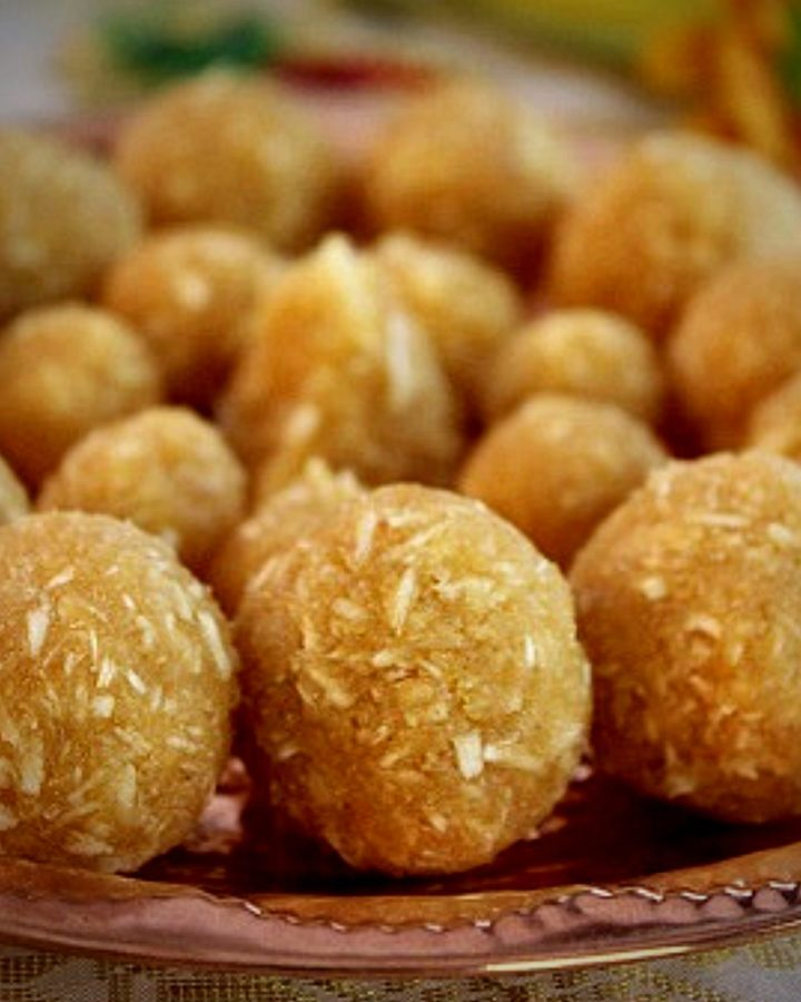 coconut jaggery ladoo served in a copper plate