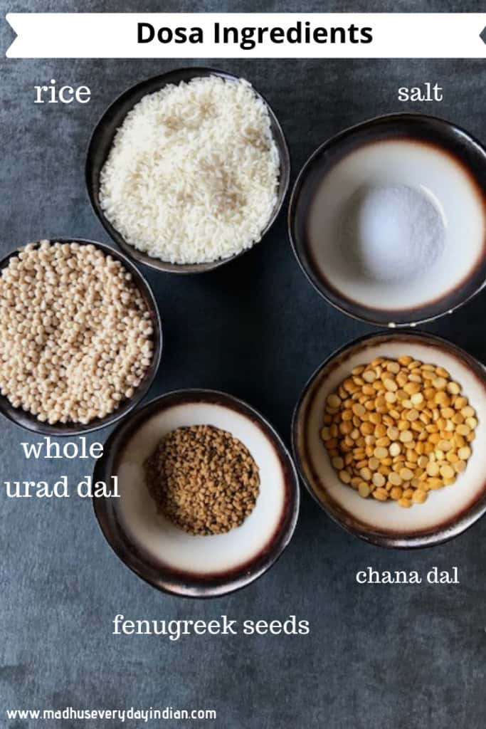 rice, urad dal, chana dal, methi seeds and salt displayed in small bowls