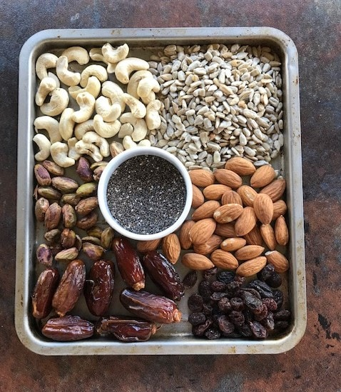 cashew, sunflower seeds, pista, chia seeds, almonds, raisins and dates in small tray