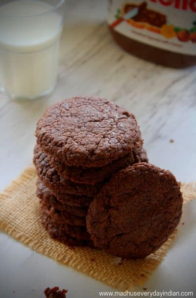 stacked nutella cookies served with cold milk