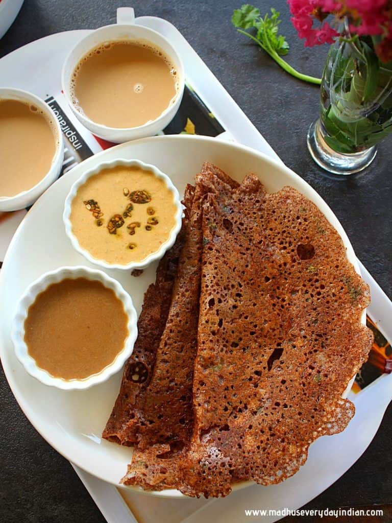 ragi dosa served in a white place with chutney and coffee