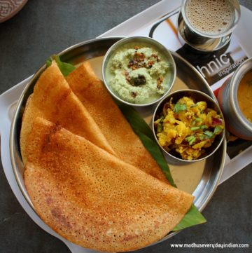 instant wheat dosa served in asteel plate with coconut chutney, potato fry, sambar and coffee