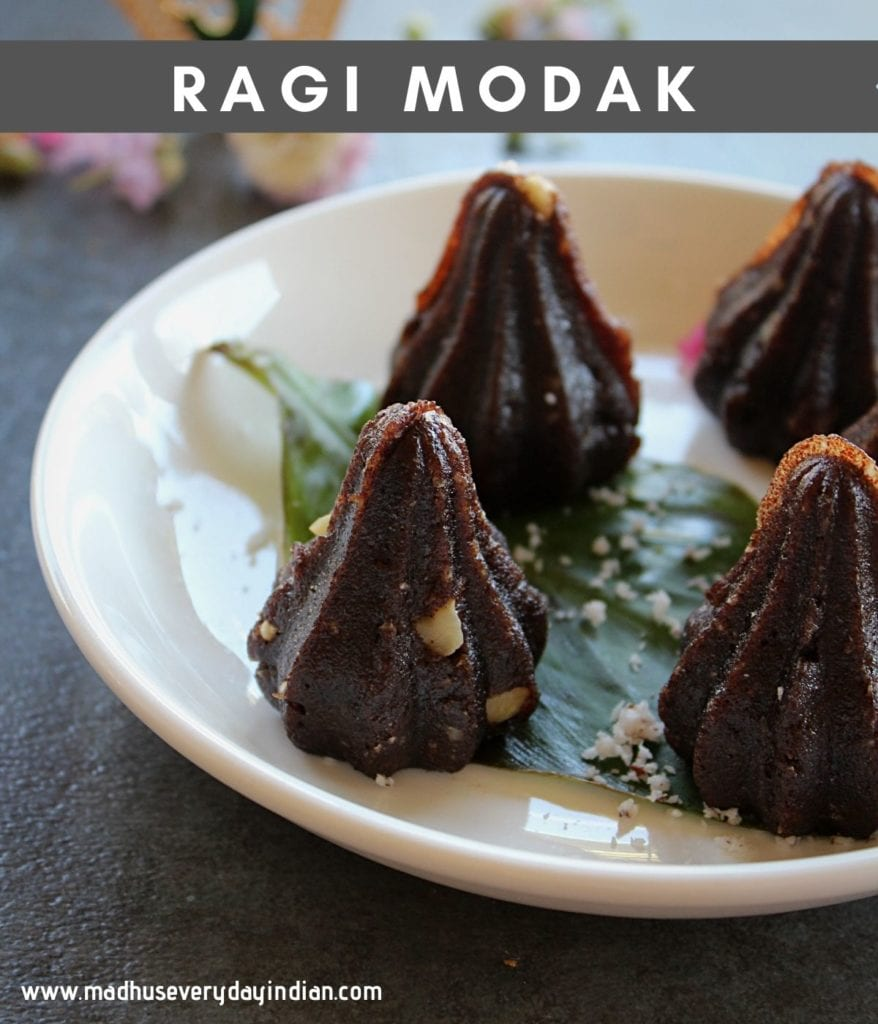 ragi modak arranged in a white plate and garnished with coconut