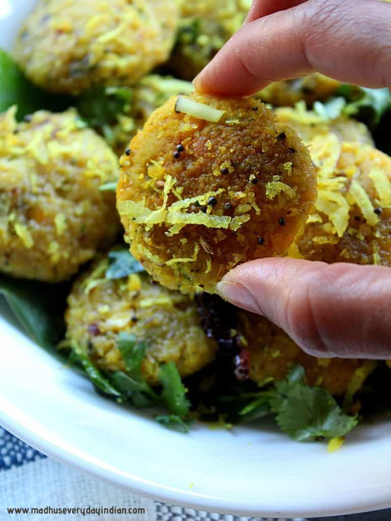 steamed chana dal vada held in fingers