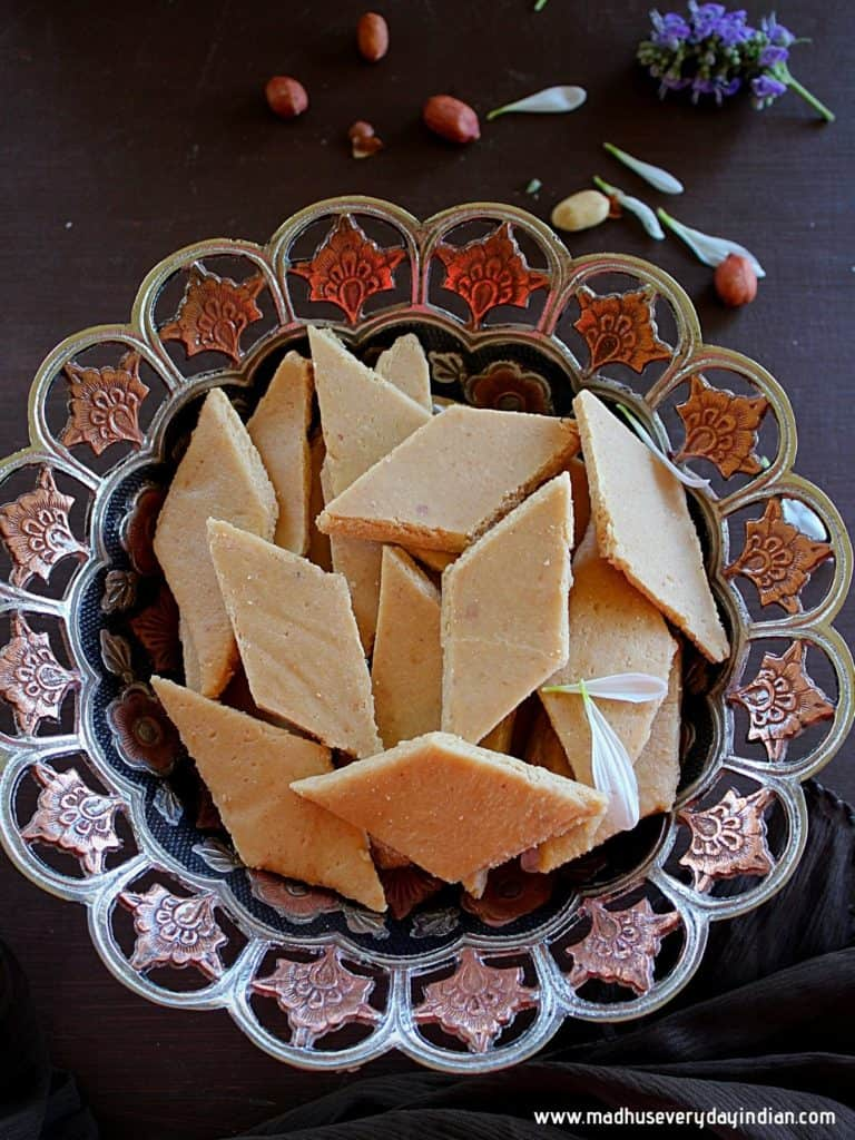peanut katli stacked in a brown and black fancy bowl