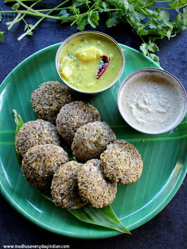 steamed green moong dal masala vada served with peanut chutney and yogurt gravy