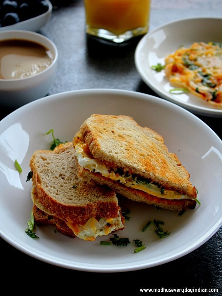 easy egg sandwich served in a white bowl with coffee and chili sauce