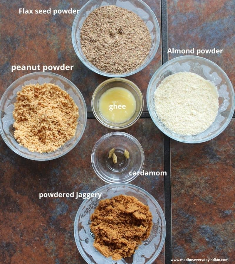 flax seeds, almond, peanuts powder, jaggery powder, ghee and cardamom in glass bowls
