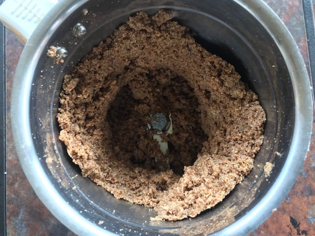 ground jaggery , nuts and flax mixture