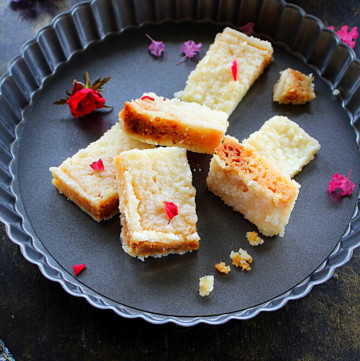 milk cake pieces garnished with rose petals