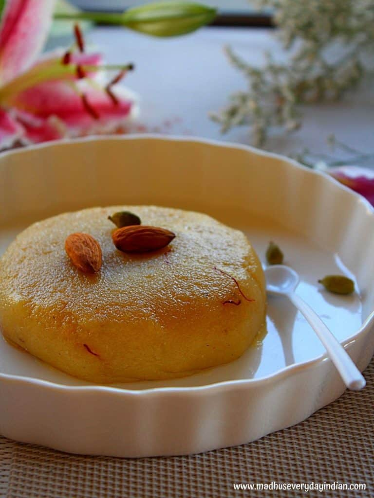 almond flour halwa served in a hite plate topped with almonds