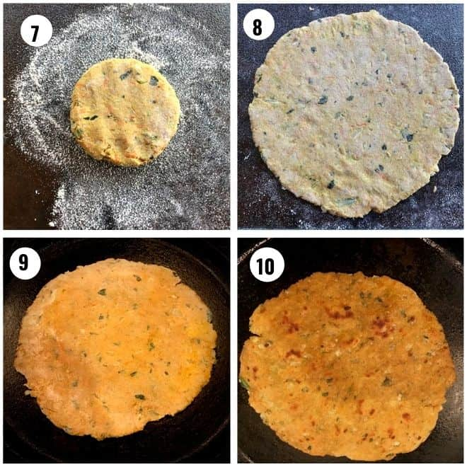 rolling the paratha dough in to a large circle and cooking it on both sides in a pan