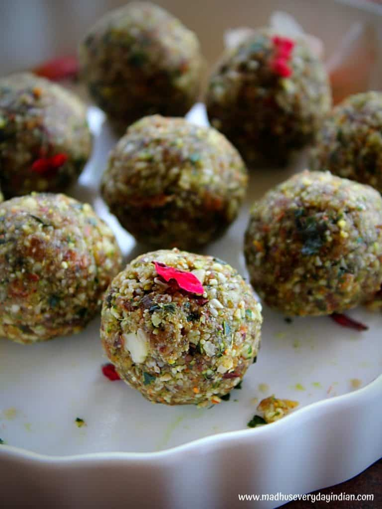 zoomed picture of paan coocnut ladoo garnished with rose petals