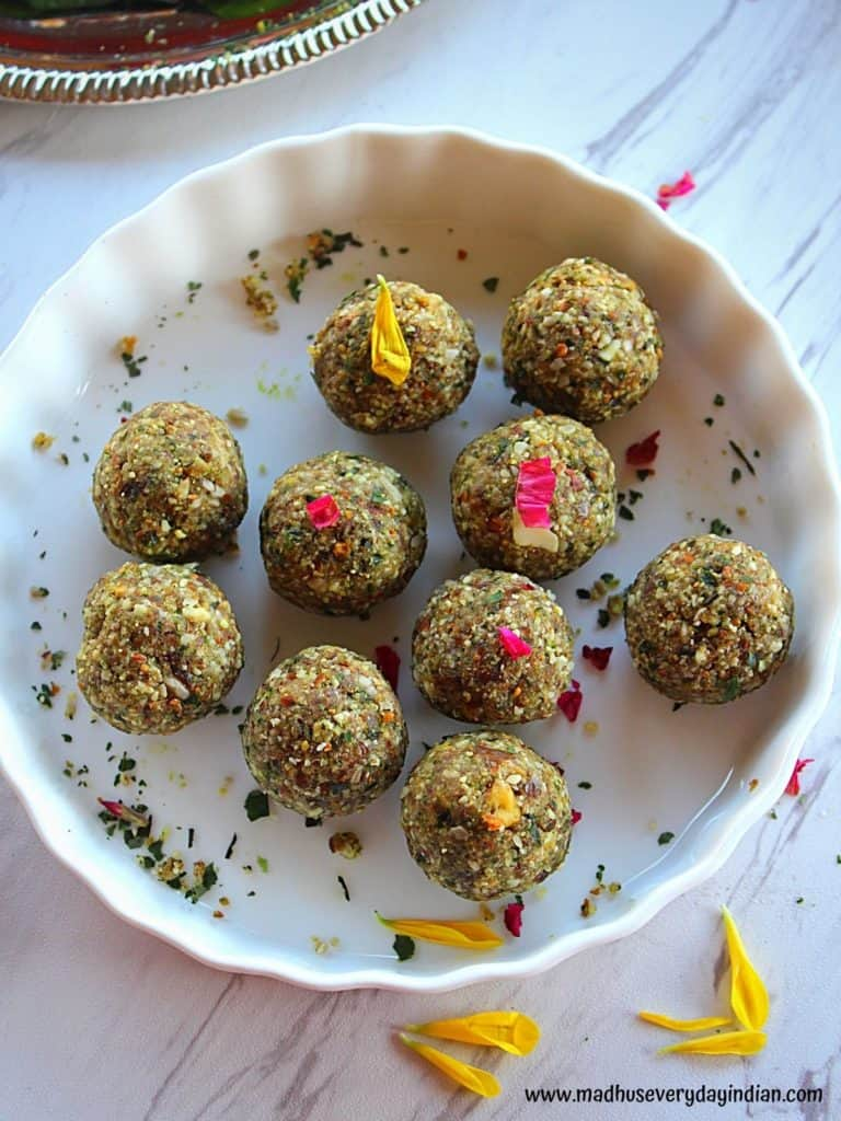 paan coconut nuts ladoo served in a white bowl garnished with rose peta;s