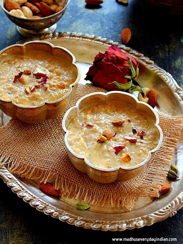 quinoa kheer served in 2 sliver small bowls yopped with nuts
