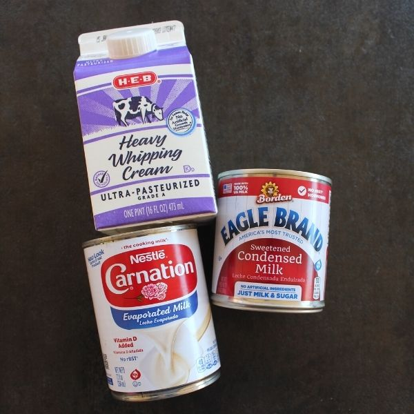 in the pciture are heavy whipping cream, evaporated milk and sweetened condensed milk