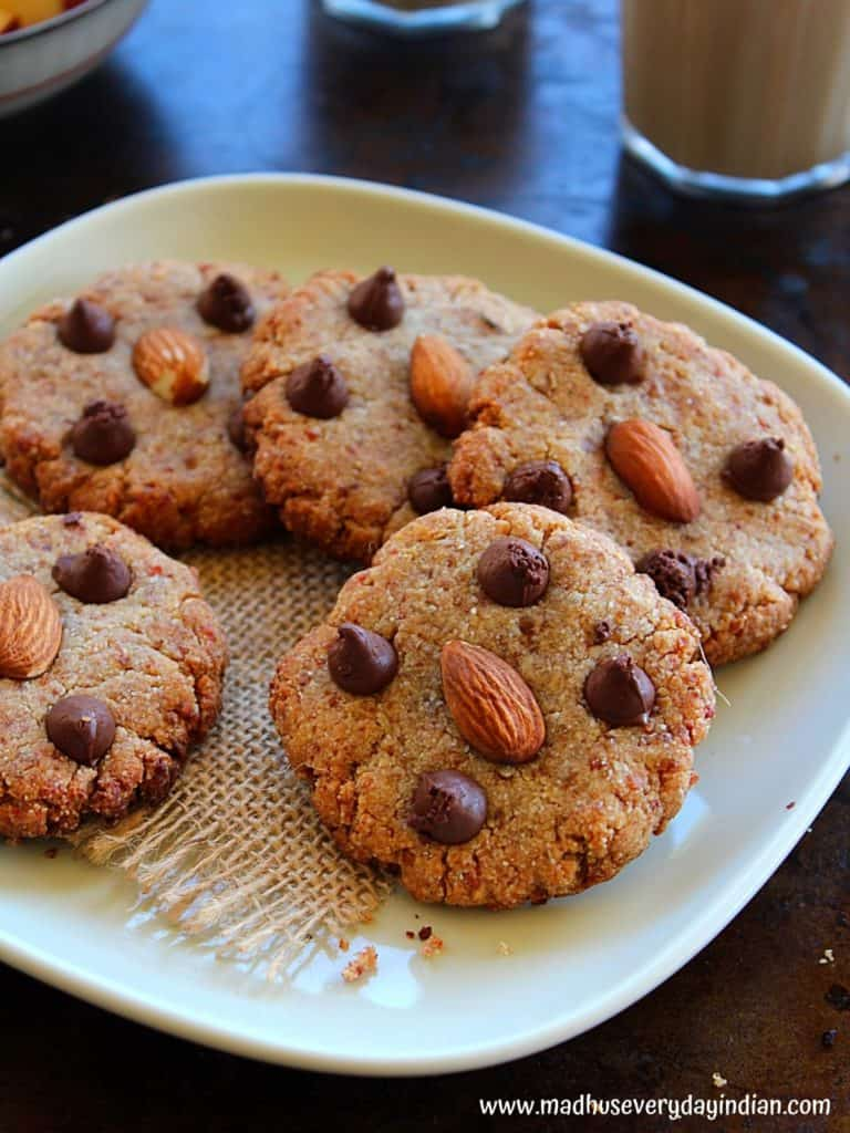 vegan almond flour cookies served in a plate with some coffee