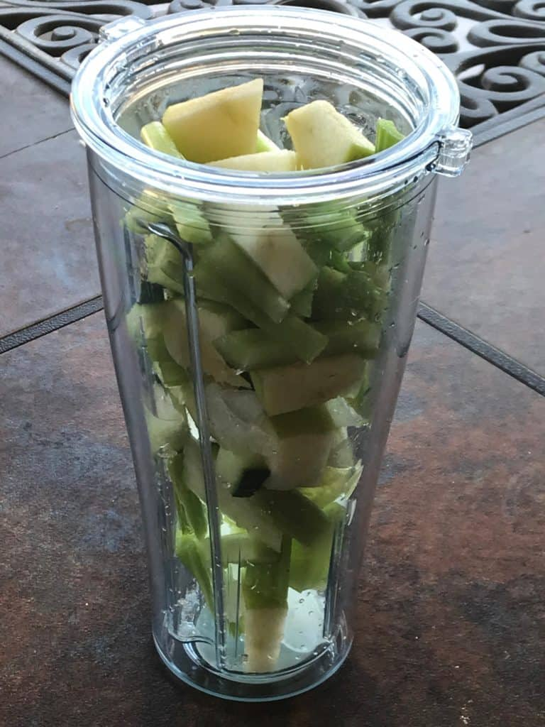 celery, green apple, ginger, cucumber and water added to a blender