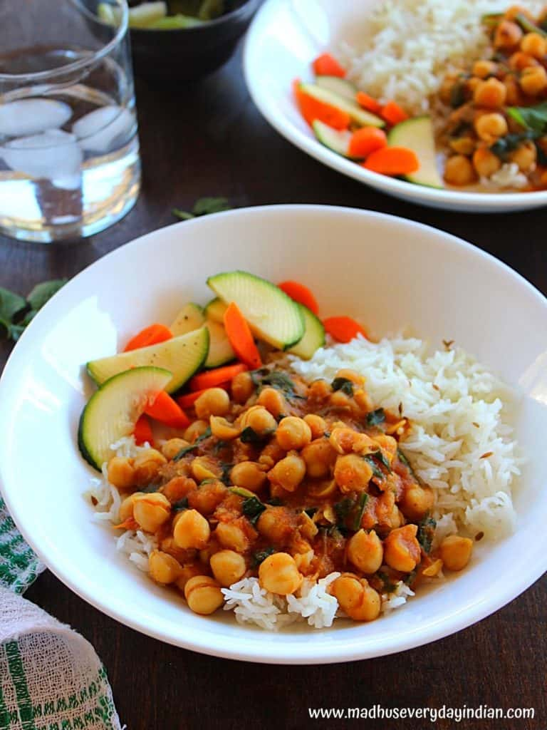 coconut chickpea curry served with cumin rice and salad and water