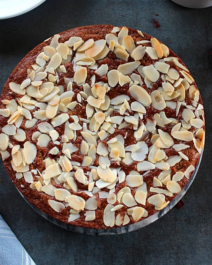 eggless almond cake topped with slivered almonds