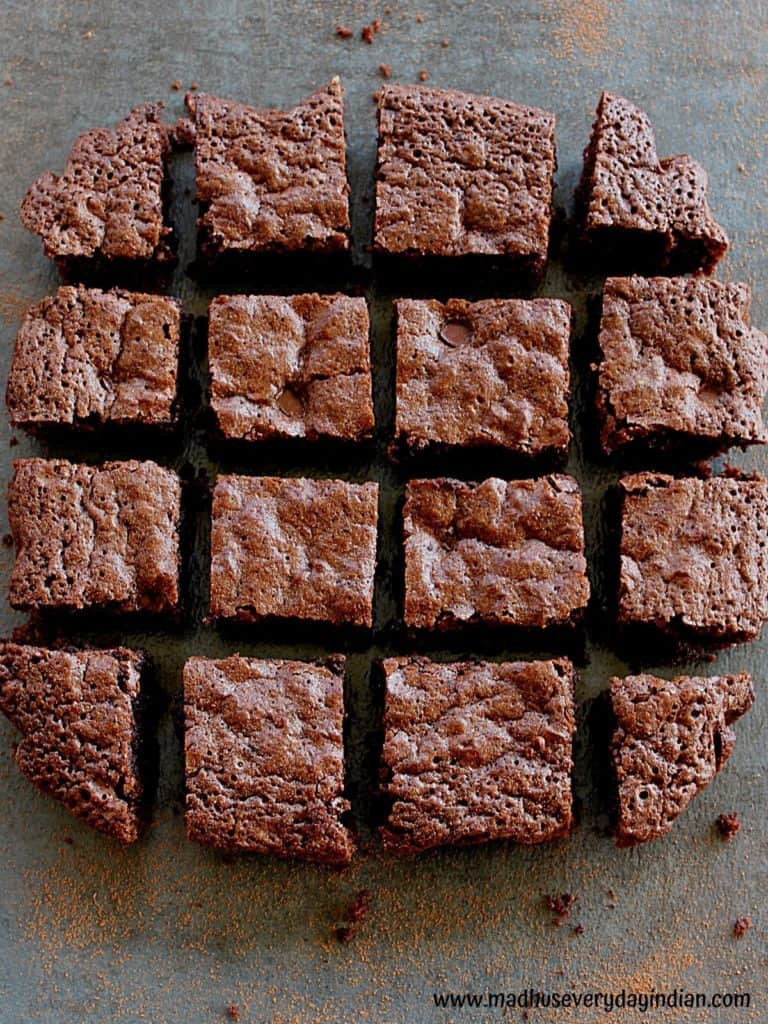 almond flour and oats brownies arranged in one layer in black back ground