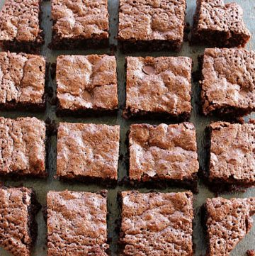 gluten free brownies wwith almond flour placed in one layer in black back ground