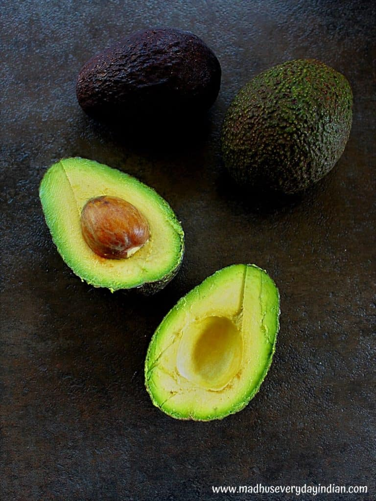 picture of whole avocado and cut avocado